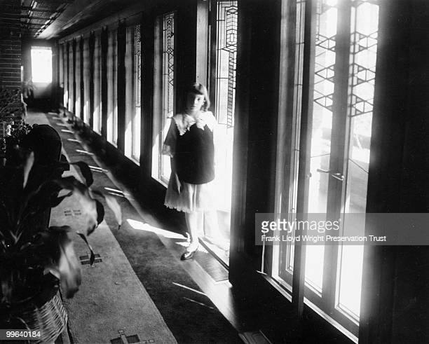 South hall looking east with Jeannette Wilber standing in doorway to the south balcony Chicago Illinois 1916