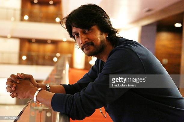 NEW DELHI INDIA OCTOBER 11 South Indian Actor Kiccha Sudeep during a shoot on October 11 2012 in New Delhi India