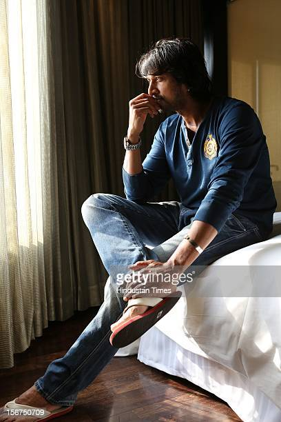 'NEW DELHI INDIA OCTOBER 11 South Indian Actor Kiccha Sudeep during a shoot on October 11 2012 in New Delhi India '