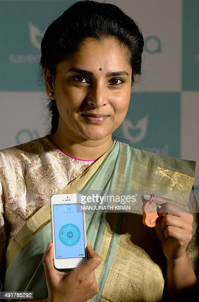 South Indian actress Ramya who is the brand ambassador for 'AVA' a personal safety enabler device and its mobile app poses for a photograph during...