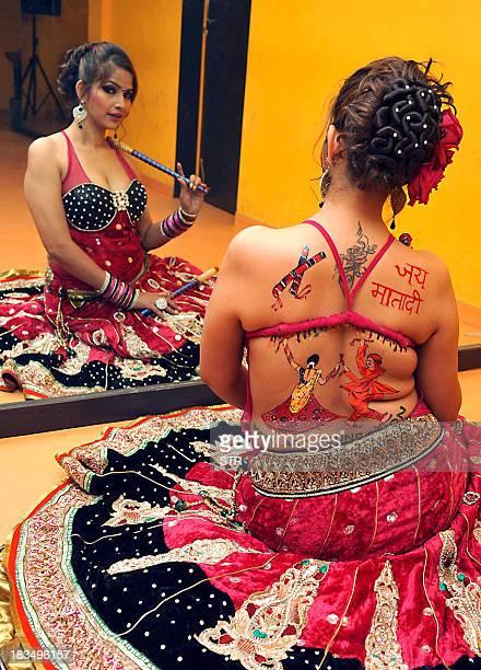 South Indian actress Tanisha Singh poses during a backless Body painting photo shoot for a Dandiya Raas folk dance as part of Navratri festival...