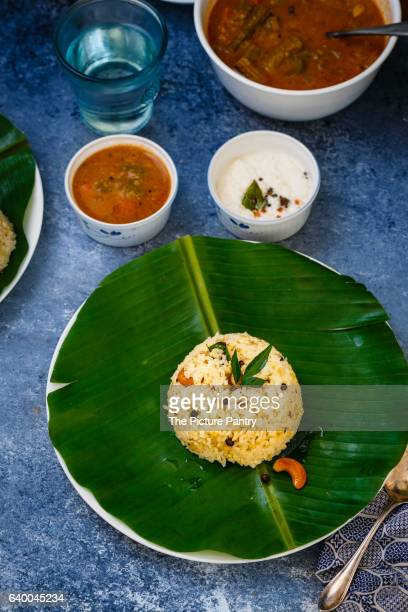 South Indian Breakfast Dish, Ven Pongal served with Sambar and Coconut Chutney