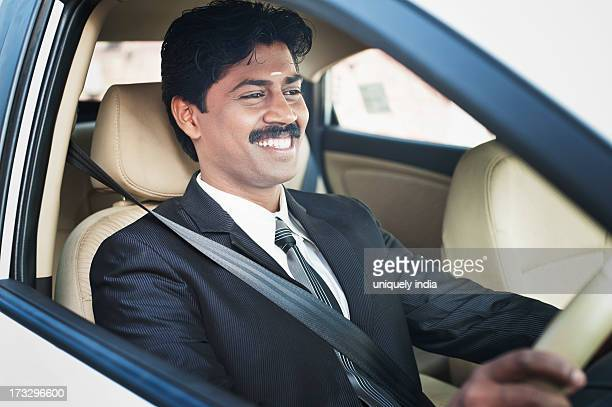 south indian businessman driving the car - formal stock pictures, royalty-free photos & images