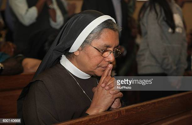 South Indian Catholic nun kneels while praying during the anniversary of the 1st Episcopal Ordination of Bishop Jose Kalluvelil in Mississauga...