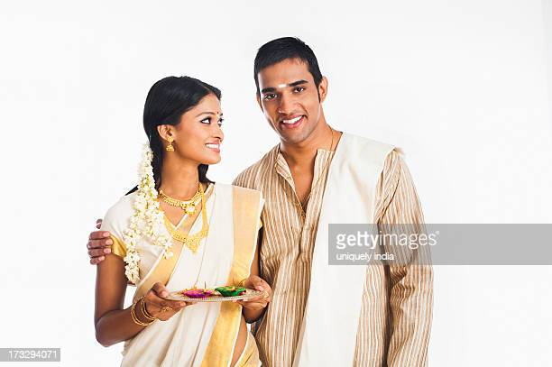 South Indian couple smiling at Onam