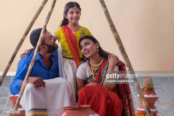 south indian family celebrating pongal - pongal festival stock pictures, royalty-free photos & images