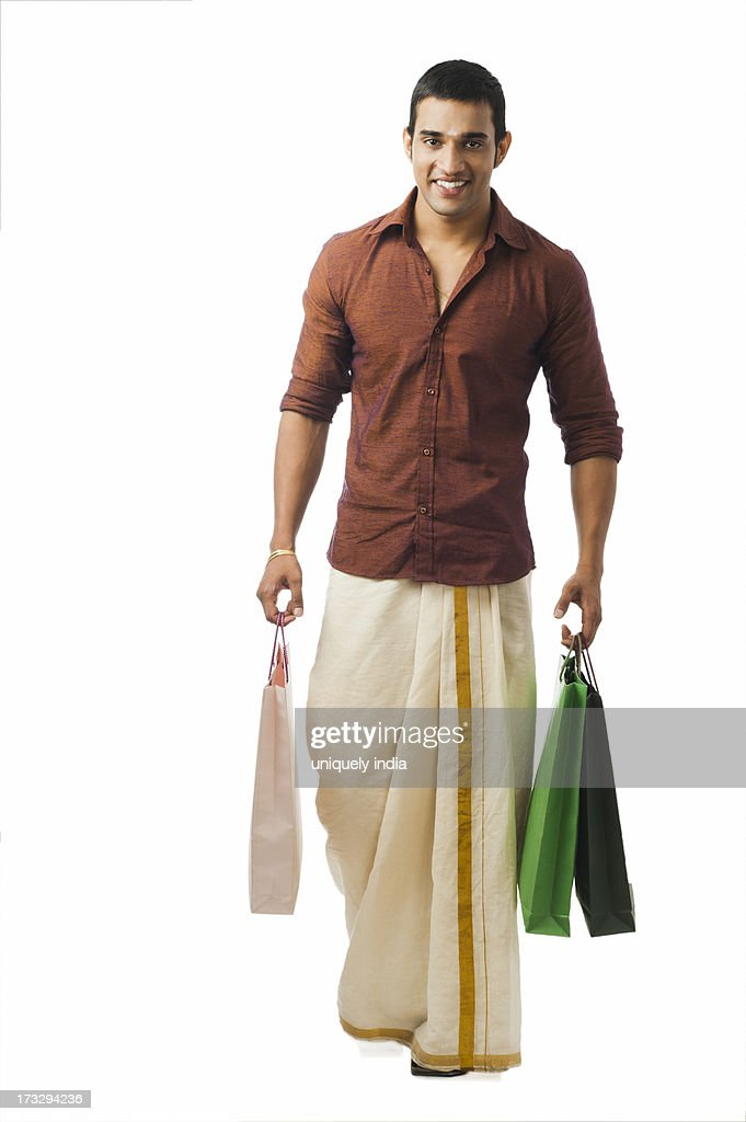 South Indian man carrying shopping bags : ストックフォト
