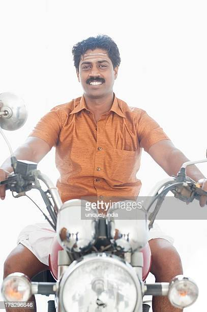 South Indian man riding a motorcycle