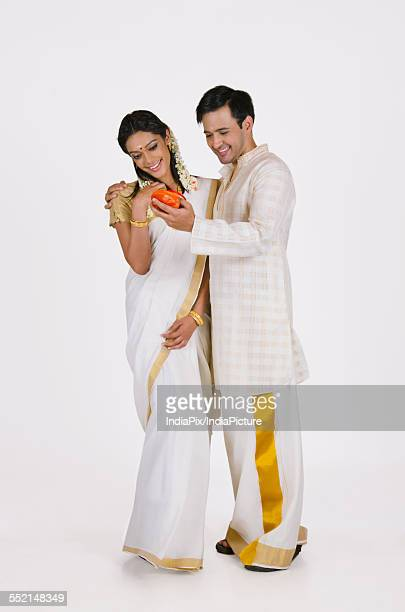South Indian man showing wife jewelery