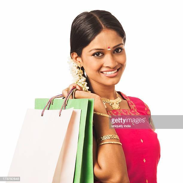 South Indian woman carrying shopping bags