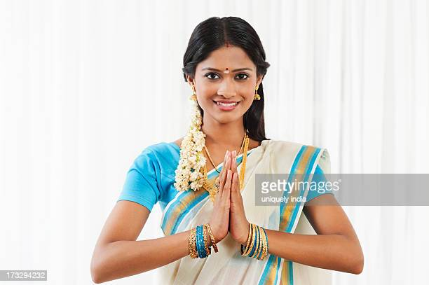 South Indian woman greeting and smiling