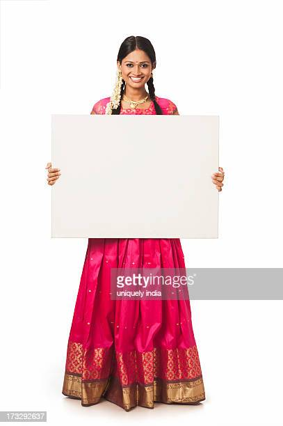 South Indian woman showing a blank placard
