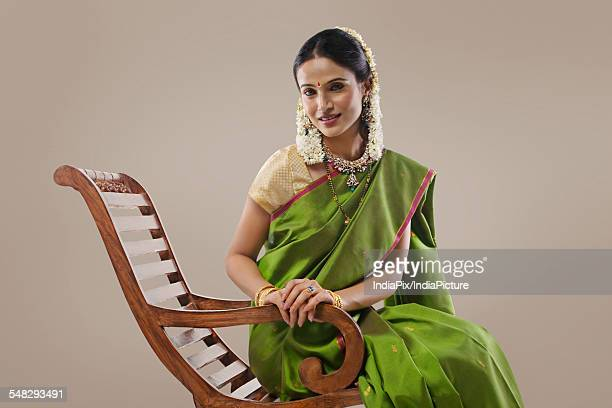 South Indian woman sitting on an arm chair