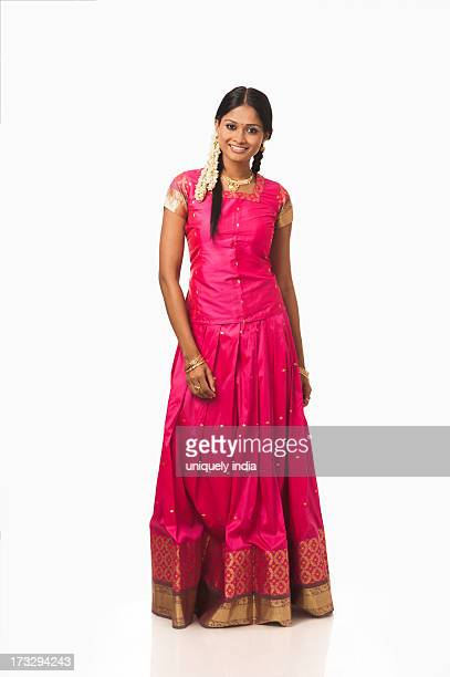 South Indian woman text messaging on a mobile phone