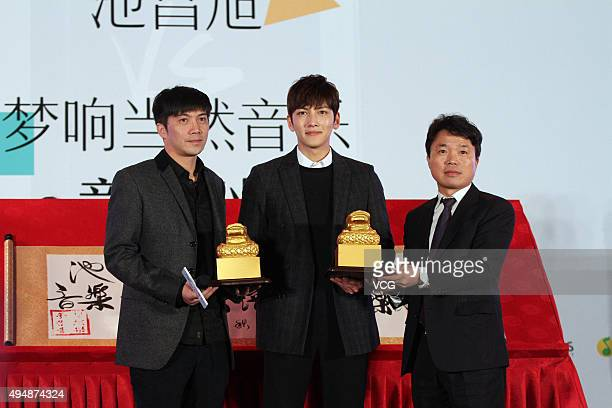 South Korea actor Ji Chang Wook attends a press conference to promote his new song as he signs cooperation with a Chinese concert band music...