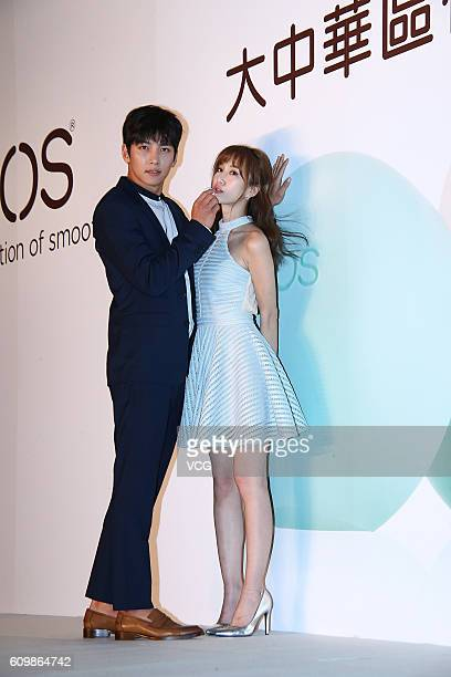 South Korea actor Ji Changwook interacts with hostess during his attending a press conference for EOS ball lip balm on September 22 2016 in Taipei...