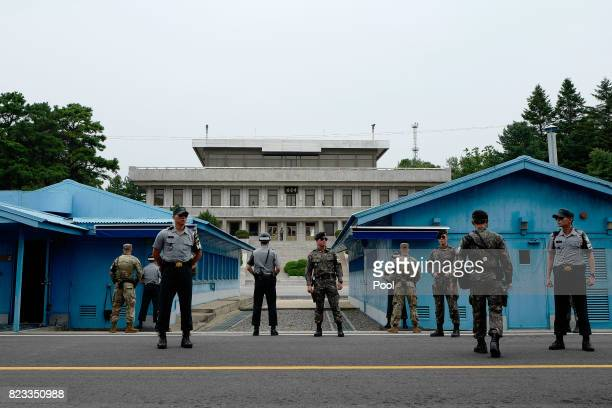 South Korea and US soldiers stand guard during an event to commemorate the 64th Anniversary of the Korean War armistice agreement in the the Joint...