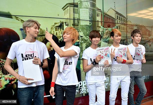 South Korea boy band LED Apple distribute leaflets to promote their concert in the street of Shibuya district on July 20, 2014 in Tokyo, Japan.