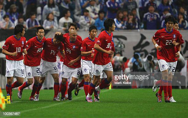 South Korea celebrate after a goal scored by Ji Sung Park during the international friendly match between Japan and South Korea at Saitama Stadium on...