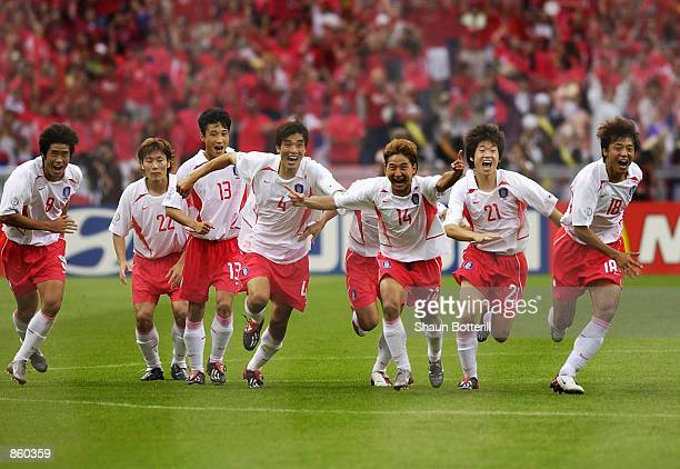 South Korea celebrate victory after the FIFA World Cup Finals 2002 Quarter Finals match between Spain and South Korea played at the Gwangju World Cup...