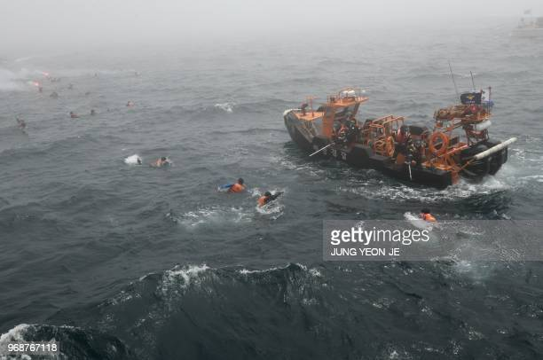 TOPSHOT South Korea Coast Guard members rescue passengers during a joint maritime antiterror drill of North Pacific Coast Guards off the southeastern...