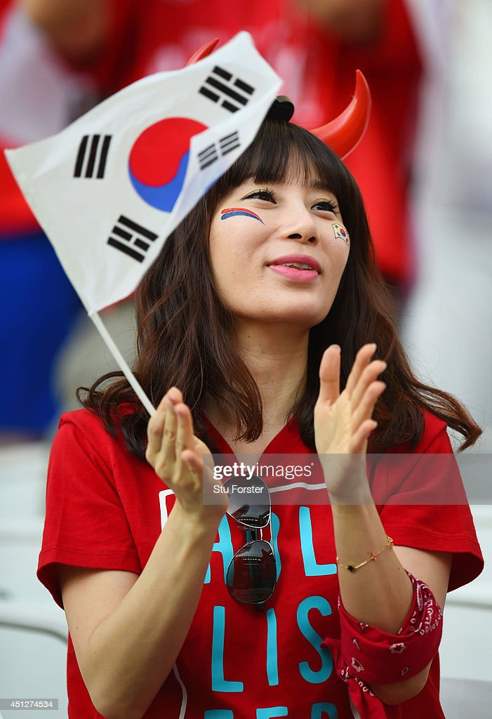 A South Korea fan enjoys the atmosphere prior to kickoff during the 2014 FIFA World Cup Brazil Group H match between South Korea and Belgium at Arena de Sao Paulo on June 26, 2014 in Sao Paulo, Brazil.