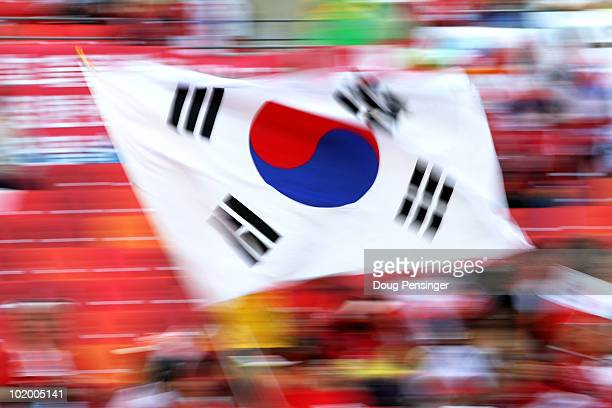 South Korea fan waves a flag prior to the 2010 FIFA World Cup South Africa Group B match between South Korea and Greece at Nelson Mandela Bay Stadium...