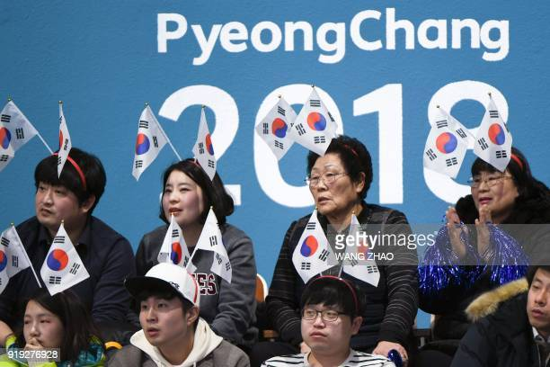 South Korea fans watch the curling women's round robin session between South Korea and Britain during the Pyeongchang 2018 Winter Olympic Games at...