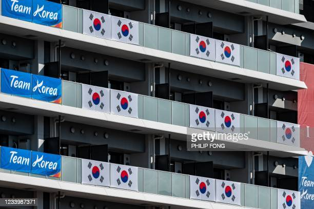 South Korea flags and signage are displayed at the Olympic and Paralympic Village in Tokyo on July 15 ahead of the 2020 Tokyo Olympic Games which...