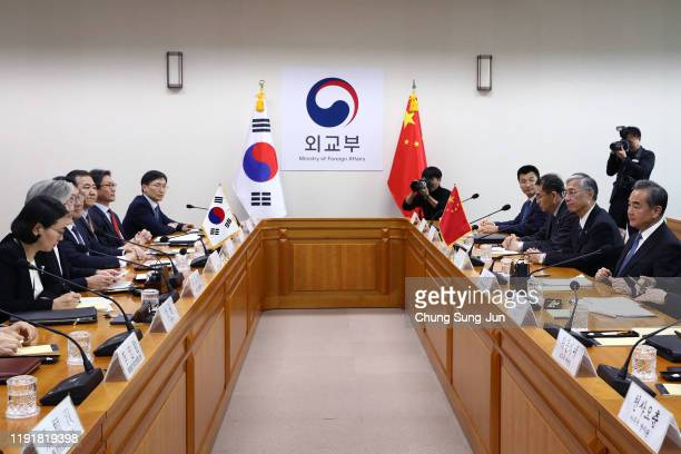 South Korea Foreign Minister Kang Kyungwha talks with Chinese Foreign Minister Wang Yi during their meeting at foreign ministry on December 04 2019...