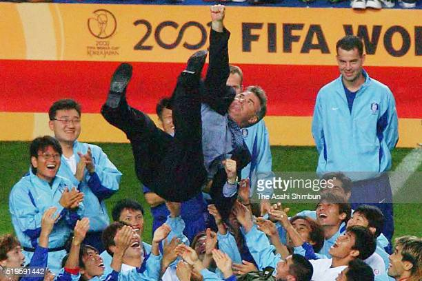 South Korea head coach Guus Hiddink is thrown into the air by his players after the FIFA World Cup Korea/Japan third place playoff match between...