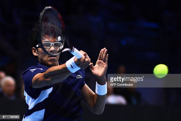 South Korea Hyeon Chung returns a shot to Russia's Andrey Rublev during their men's singles tennis match of the first edition of the Next Generation...