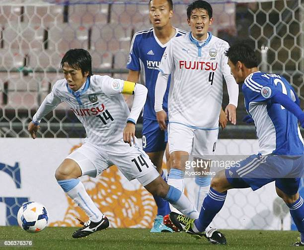 South Korea - Japan's Kawasaki Frontale midfielder Kengo Nakamura chases the ball during the first half of a Group H game against South Korea's Ulsan...