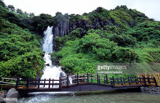 south korea, jeju island, jungmon beach, waterfall. - jeju stock photos and pictures