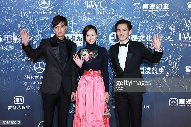 South Korea model and actor Lee Minho Chinese actress Tang Yan and Chinese singer and actor Wallace Chung arrive at the red carpet of the 6th Beijing...
