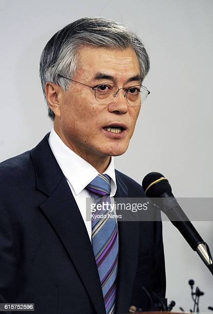 SEOUL South Korea Moon Jae In of the main opposition Democratic United Party holds a press conference in Seoul on Nov 25 after he filed his candidacy...