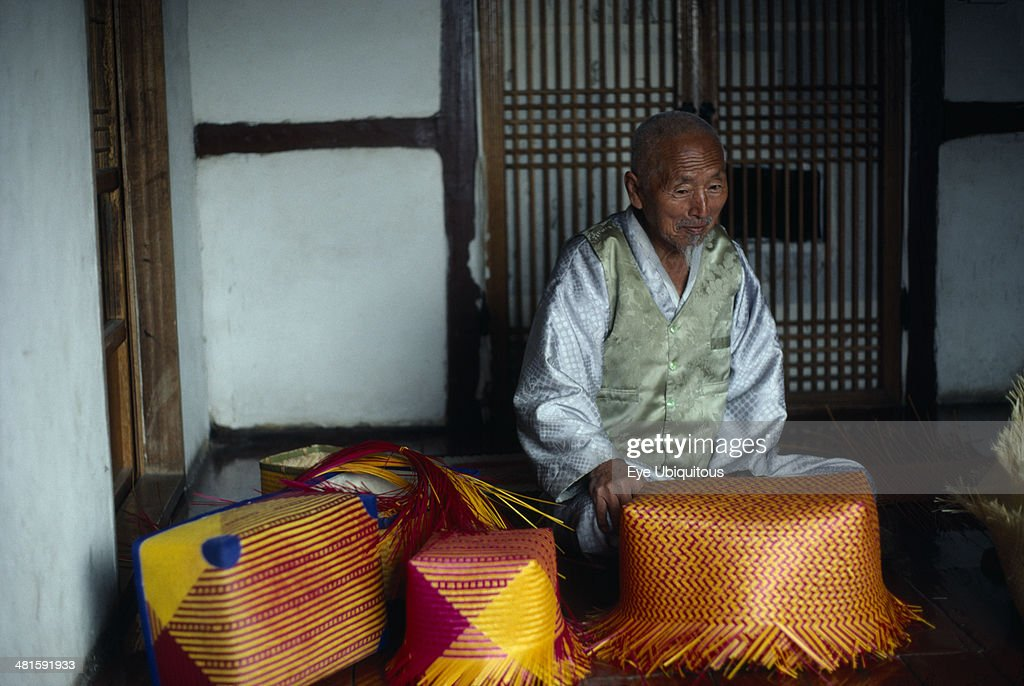 Portrait of master bamboo craftsman with examples of baskets : News Photo