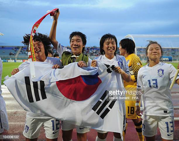 South Korea players celebrate after beating Spain at the end of the FIFA U17 Women's World Cup Semi Final match between South Korea and Spain at the...
