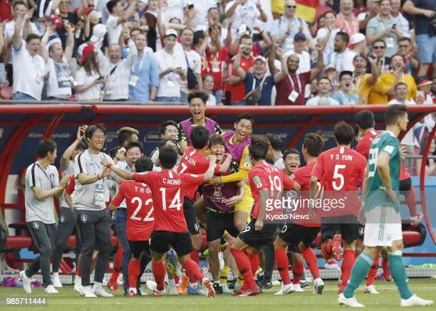 South Korea players celebrate after the Video Assistant Referee validated their goal during the second half of a World Cup Group F match against...