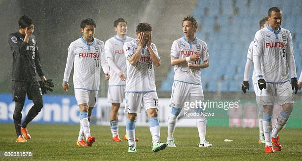 South Korea - Players of Japan's Kawasaki Frontale leave the pitch at Ulsan Munsu Football Stadium in Ulsan, South Korea, on March 12 after being...