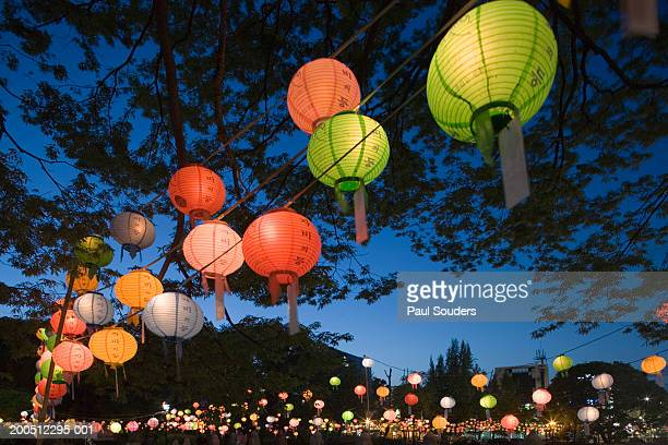 south korea, seoul, jangchung dong park, paper lanterns at dusk - buddha's birthday stock pictures, royalty-free photos & images