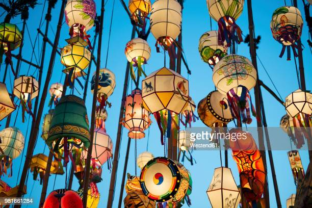 south korea, seoul, lanterns lit up in the buddhist temple of jogyesa - south korea stock pictures, royalty-free photos & images