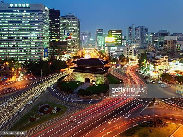 South Korea, Seoul, Namdaemun Gate and traffic, dusk, elevated view