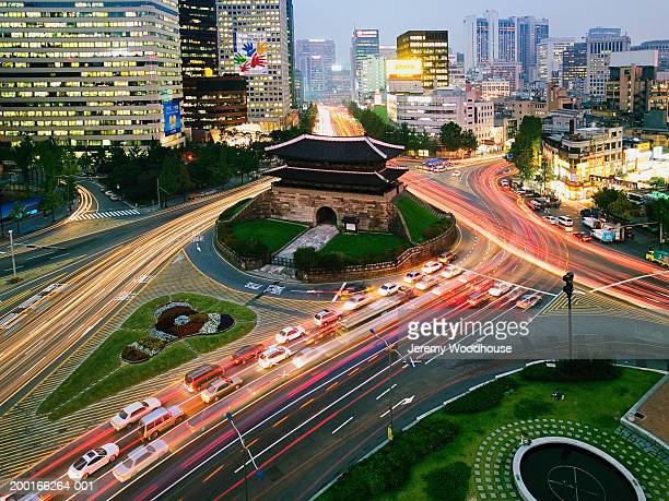 South Korea, Seoul, Namdaemun Gate and traffic, sunset, elevated view