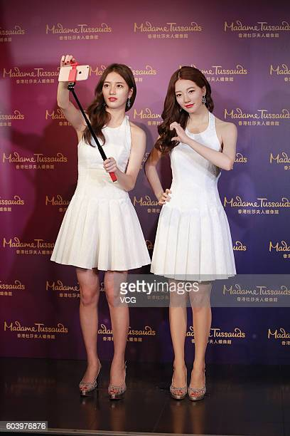 South Korea singer and actress Bae Suzy poses with her wax figure on September 13 2016 in Hong Kong China