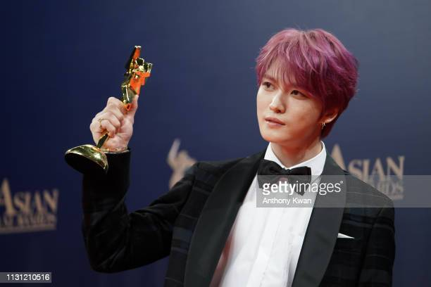 South Korea singer-actor Kim Jae-joong poses for a photograph after winning the AFA Next Generation Award the 13th Asian Film Awards on March 17,...