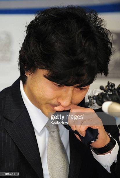 SEOUL South Korea South Korean striker Ahn Jung Hwan cries at a press conference to announce his retirement from professional soccer in Seoul on Jan...