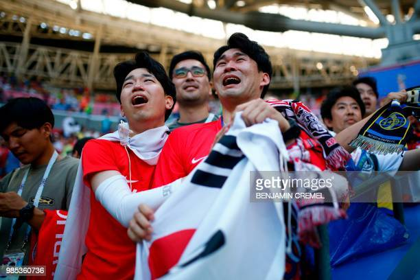 TOPSHOT South Korea supporters react at the end of the Russia 2018 World Cup Group F football match between South Korea and Germany at the Kazan...