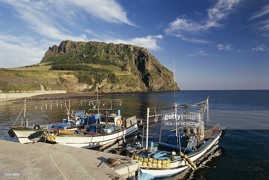Boats moored at a dock, Sunrise Peak, Cheju-Do Island, South Korea : News Photo