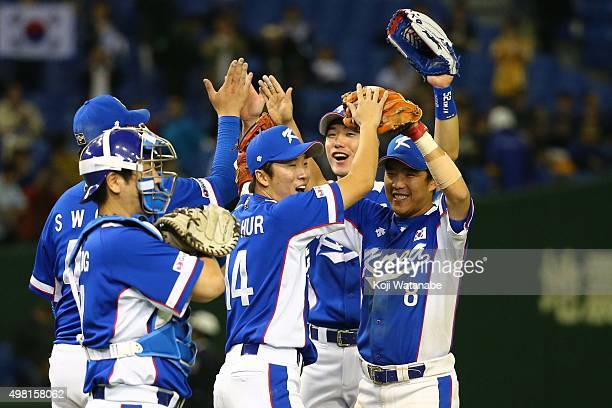 South Korea team celebrate after wininng the WBSC Premier 12 final match between South Korea and the United States at the Tokyo Dome on November 21...